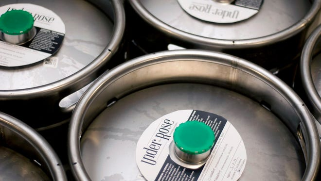 Under the Rose Brewing Co. kegs.