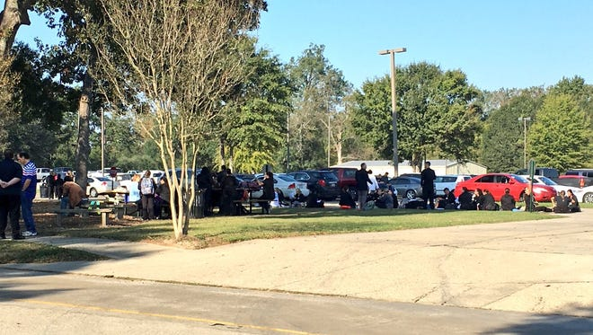 Students wait outside South Louisiana Community College's Ardoin building Tuesday morning. The building was evacuated due to a propane leak.