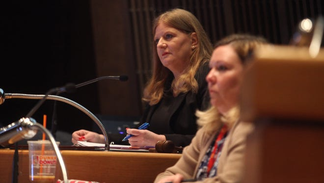 New Castle County Council President Karen Hartley-Nagle watches presides of council with her former aide, Kate Maxwell, to the right.