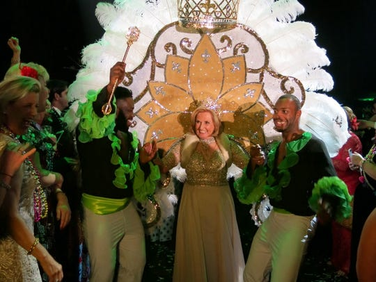 Krewe Justinian Queen XXIV Tracey Cox is escorted by Tropicana  Dancers as she makes her entrance at Justinian Grand Bal.