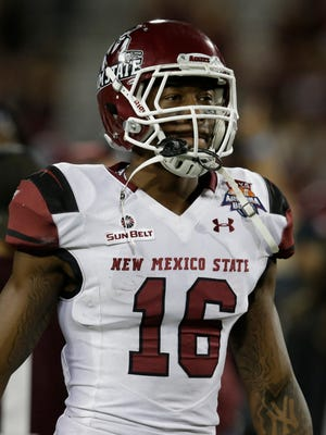 New Mexico State wide receiver Jaleel Scott (16) in the second half during the Arizona Bowl NCAA college football game against Utah State, Friday, Dec. 29, 2017, in Tucson, Ariz. New Mexico State defeated Utah State 26-20 in overtime. (AP Photo/Rick Scuteri)