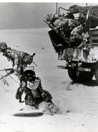 A gun team from Battery B, 1st Battalion, 320th Field Artillery Regiment, 101st Airborne Division, react to a simulated emergency fire mission during training in 1990.