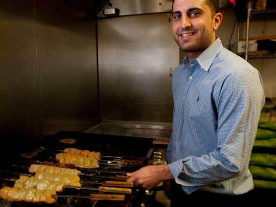 Omar Ahmady prepares beef and chicken kabobs in the kitchen of Babur Garden in Ocean Township.