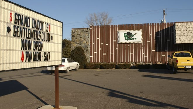 Grand Daddy's has agreed to pay $100,000 to settle a class-action fair wage lawsuit brought by dancers who worked at the Schofield gentlemen's club since May 2012, according to documents filed in federal court.