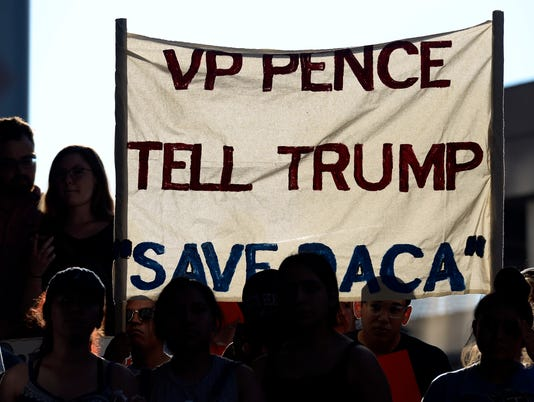 636373902230231495-NAS-Immigrant-Pence-Protest-002.jpg