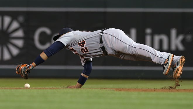 Detroit Tigers first baseman Miguel Cabrera dives for a sharp grounder as Minnesota Twins' Danny Santana hits an RBI single in the eighth inning of a baseball game, Wednesday, Sept. 17, 2014, in Minneapolis. Cabrera went 4-for-5 at the plate. The Twins won 8-4.