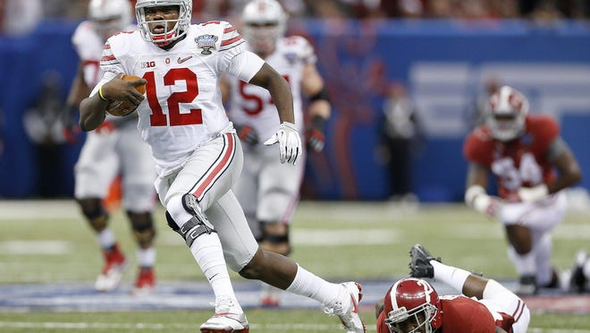 Ohio State quarterback Cardale Jones (12) gets away from an Alabama defender during the Buckeyes' playoff victory over the Crimson Tide in 2015. The schools have scheduled a home-and-home series for the 2027 and 2028 seasons.