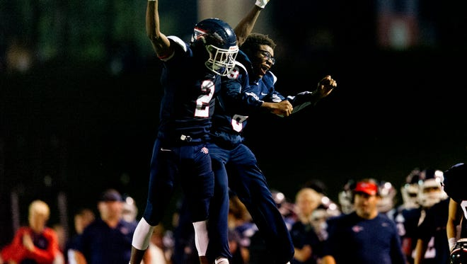 South Doyle's Elijah Young (2) and Ralph Lee (8) celebrate after Young's touchdown South Doyle's during a game between South Doyle and Halls at South Doyle High School in Knoxville, Tennessee, on Friday, October 6, 2017.