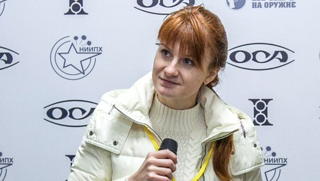 Mariia Butina, leader of a pro-gun organization, speaks on October 8, 2013 during a press conference in Moscow.  A 29-year-old Russian woman has been arrested for conspiring to influence US politics by cultivating ties with political groups including the National Rifle Association, the powerful gun rights lobby.