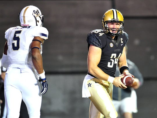 Vanderbilt's Andrew East (34) smiles after catching a pass for a two-point conversion against Charleston Southern on Oct. 11, 2014, in Nashville.