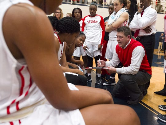 Pike coach Bob Anglea works with his team during a