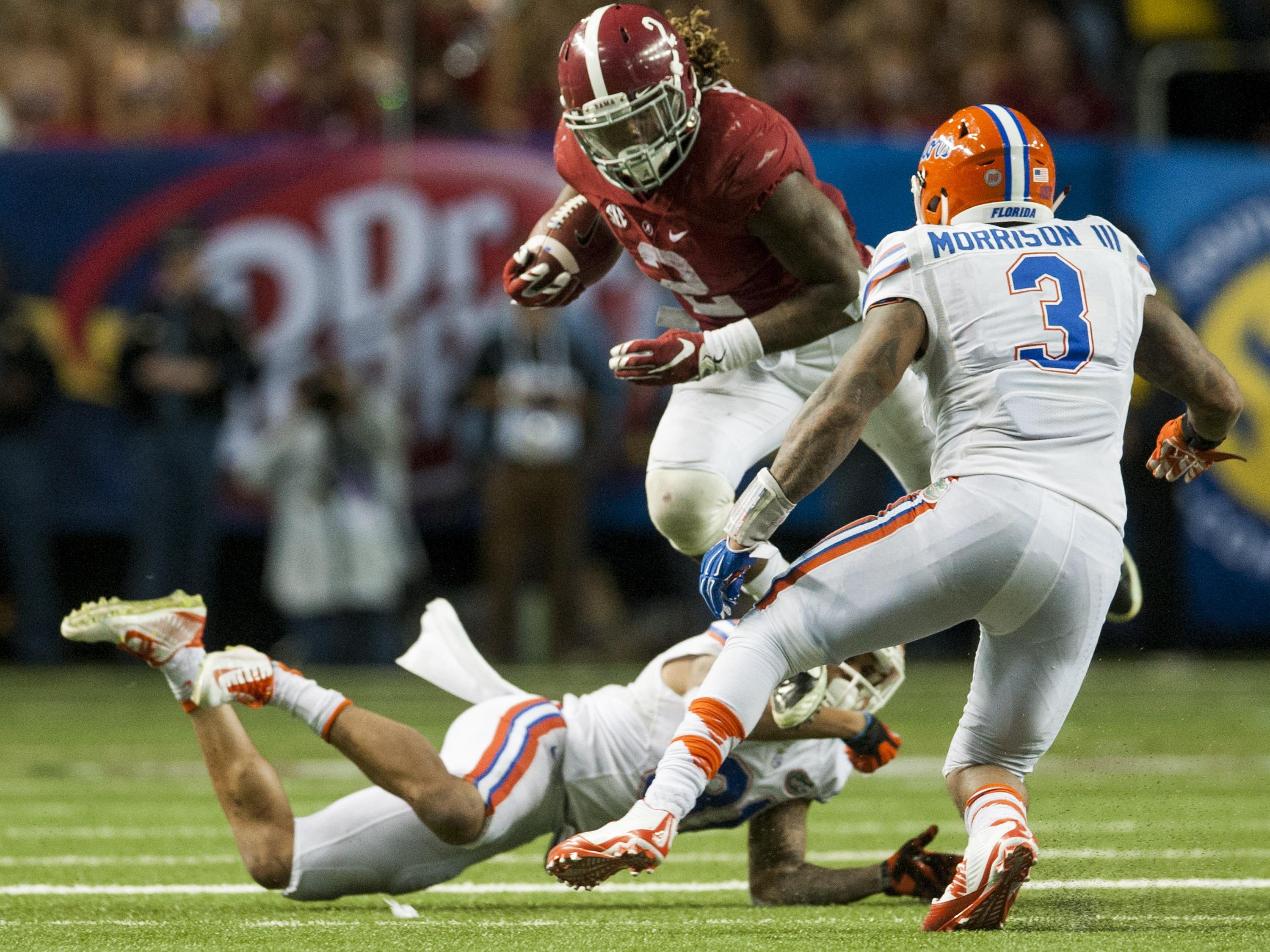 Alabama running back Derrick Henry (2) fights for yardage against Florida in the SEC Championship Game in Atlanta, Ga. on Saturday December 5, 2015. (Mickey Welsh / Montgomery Advertiser)