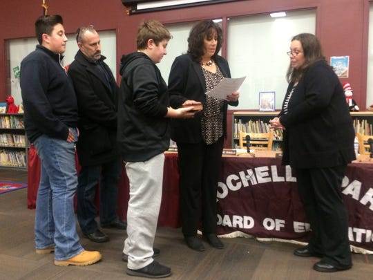 Arlene Ciliento-Buyck being sworn in to serve on the Rochelle Park Board of Education during its annual reorganization meeting on Thurs., Jan 5, 2017. She was sworn in alongside her family.