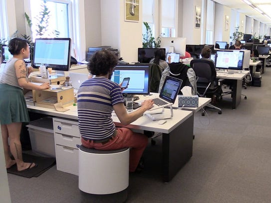 Workers at Paperless Post, a New York City startup