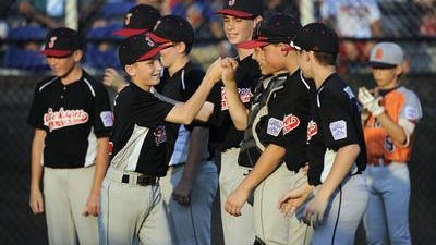 Jackson Little League players celebrate on their way to the Mid-Atlantic Regional final.