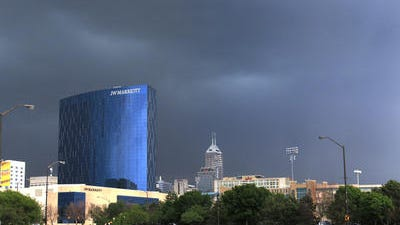 Dark clouds are shown rolling through Downtown Indianapolis in this view looking east on West Washington Street next to White River State Park in May. Another storm was causing some power outages in the metro area on Wednesday, June 18.