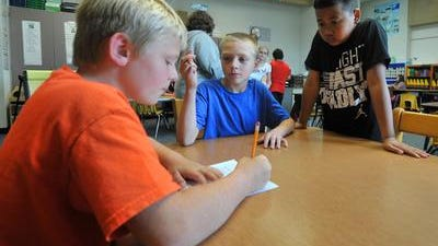 Fourth graders at Lincoln Elementary School brainstorm ideas for writing a story in September. A forum at the Wisconsin Institute for Public Policy and Service will explore the impact that school choice has on public schools such as Lincoln.