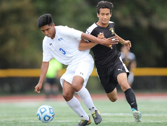 Piero Urteaga (3) and Passaic Tech shields the ball