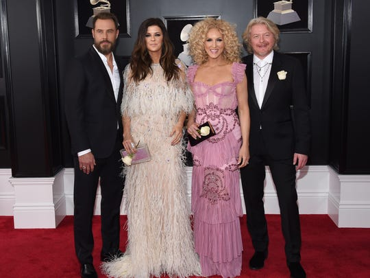Jimi Westbrook, from left, Karen Fairchild, Kimberly Schlapman and Philip Sweet of Little Big Town arrive at the 60th annual Grammy Awards at Madison Square Garden on Sunday, Jan. 28, 2018, in New York.