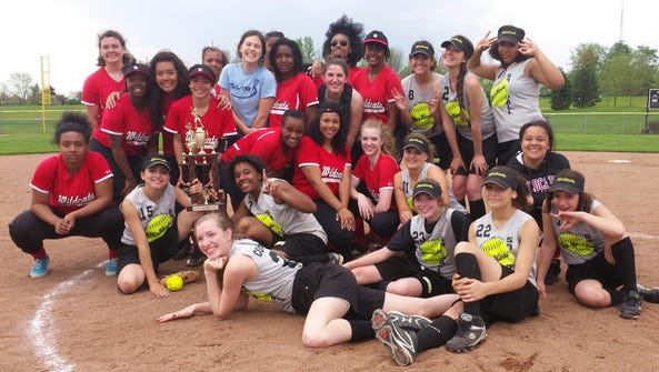 """SOTA and Wilson girls softball players pose after SOTA's 8-6 win for city title last week. SOTA athletic director Dave Michelsen calls this, """"The true meaning of sports. ... You really can't tell who won."""""""