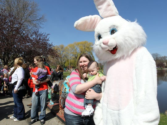 Sarah and Nathan Miller stand by the Easter Bunny,