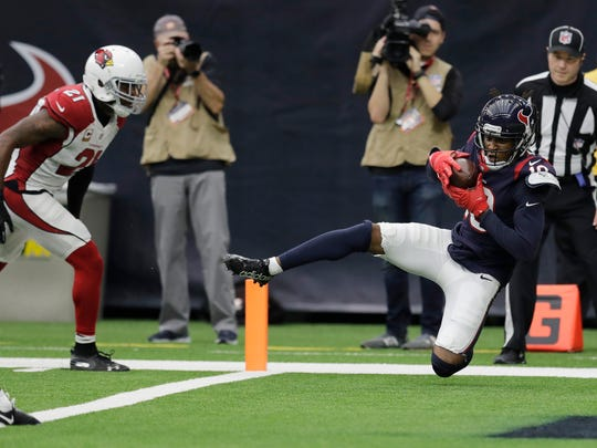 Houston Texans wide receiver DeAndre Hopkins (10) makes a catch for a touchdown in front of Arizona Cardinals cornerback Patrick Peterson (21) during the second half of an NFL football game, Sunday, Nov. 19, 2017, in Houston.