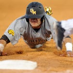 Southern Miss player Chase Scott (23) dives to third during a game against FAU in the CUSA tournament at Pete Taylor Park Friday.