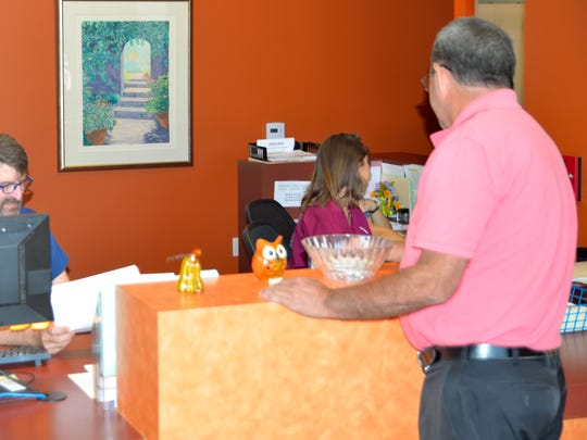 In addition to this front desk area, the clinic includes six exam rooms and numerous amenities.