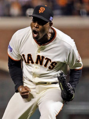 San Francisco Giants relief pitcher Santiago Casilla celebrates a 6-4 win over the St. Louis Cardinals in Game 4 of the NLCS Wednesday night in San Francisco. The Giants  lead the series 3-1.