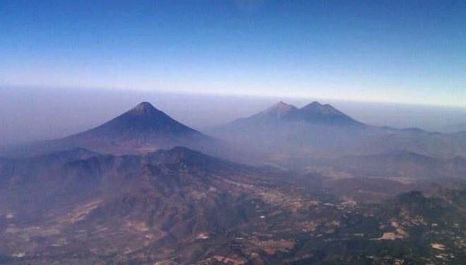 Volcanoes peek through the haze in Guatemala last month.