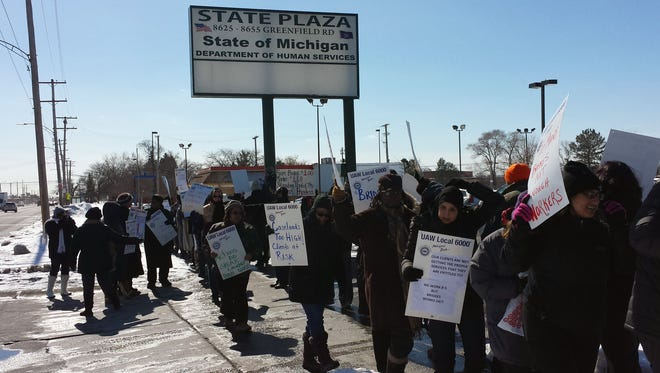 Employees of the Michigan Department of Human Services in Detroit are seen protesting high caseloads in this photo provided by the United Auto Workers Local 6000, which represents the DHS employees.