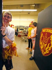 """Alex Linse waits for a foul to be a part of the """"Curtain of Distraction"""" on Feb. 22, 2015 in Tempe."""