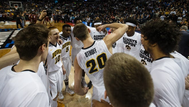 Iowa's Jarrod Uthoff gets his teammates fired up prior to the NCAA Tournament opener against Temple on Friday.