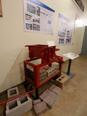 A cement block maker is on display April 15 at the
