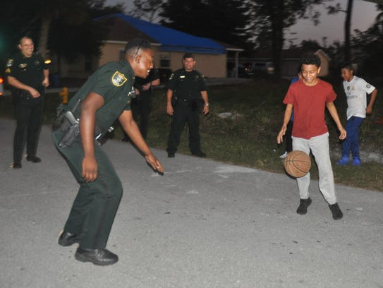 After delivering a bicycle deputies played basketball