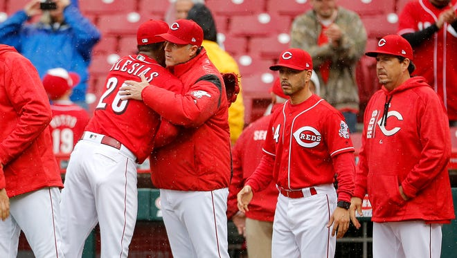 Red manager Bryan Price congratulates relief pitcher Raisel Iglesias after the Reds beat the Pirates 4-2 at Great American Ball Park.