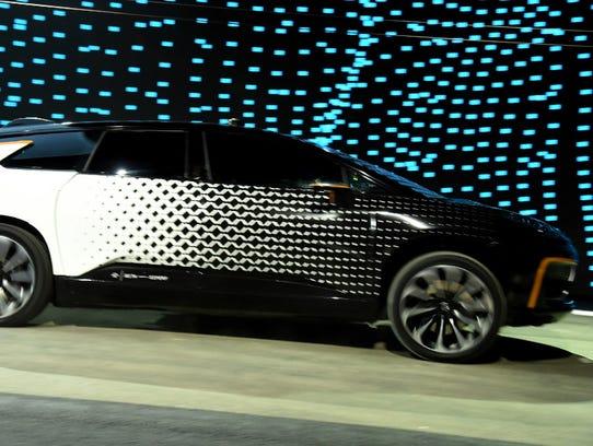 Faraday Future unveiled a slight camouflaged version