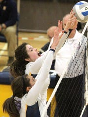 Hartland's Sarah Skinner, back, and Carson Vestergaard have played key roles in the Eagles' fast start this season.