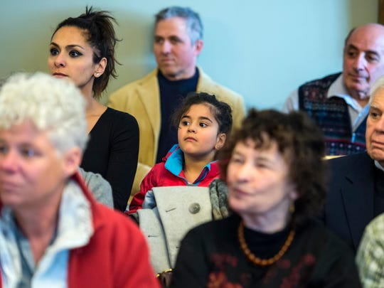 Agata Ayrapetian, (left) of Richmond and daughter Rafi, 5, listen to a presentation Tuesday at the Statethouse on the genocide in Armenia.