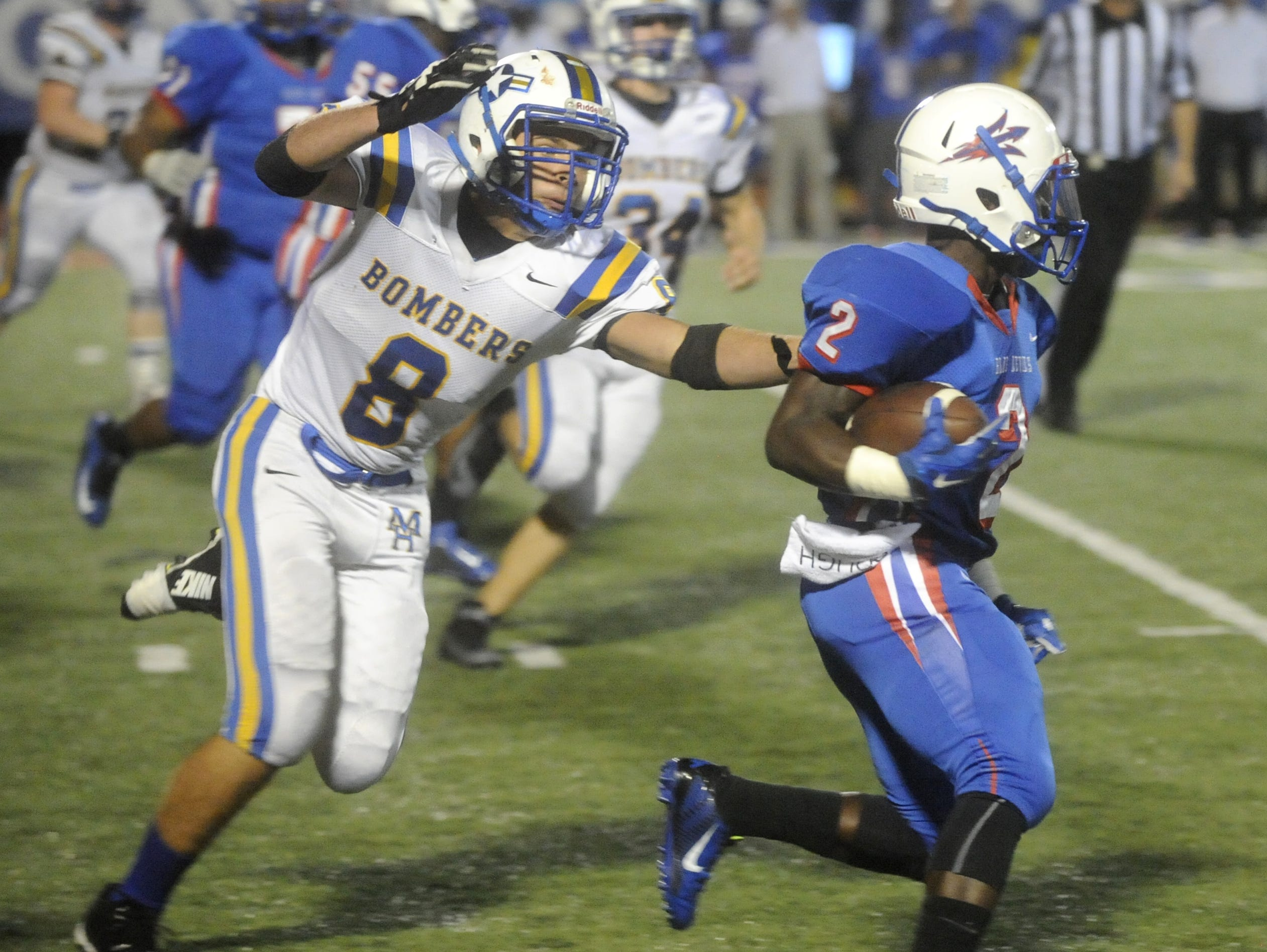 Mountain Home's Cord Smith (8) chases down a West Memphis running back during last week's game.