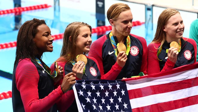 Aug 13, 2016; Rio de Janeiro, Brazil; Simone Manuel (USA) , Kathleen Baker (USA) , Dana Vollmer (USA) , Lilly King (USA) with their gold medals after the women's 4x100m medley relay final in the Rio 2016 Summer Olympic Games at Olympic Aquatics Stadium.