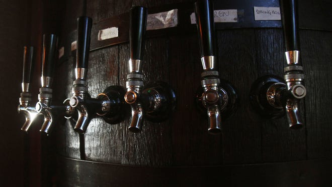 The cider taps behind the bar at McDonald and Peacock Cider Bar on North Division Street in Peekskill Sept. 15, 2016.
