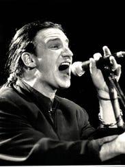 Bono leads U2 at the Pontiac Silverdome on April 30,
