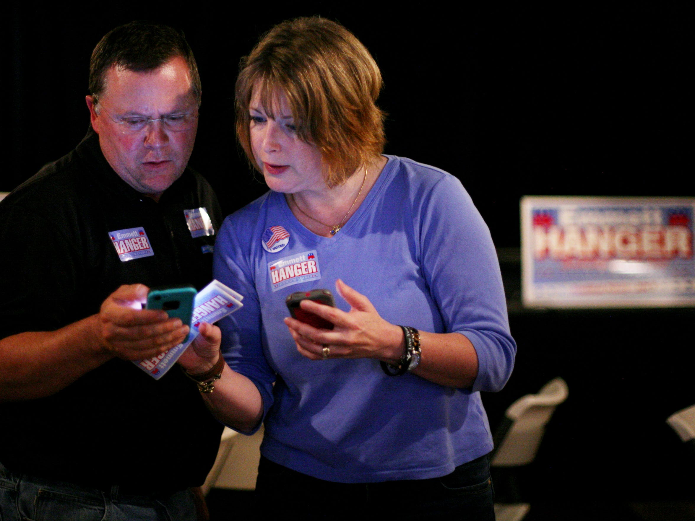 Legislative aide Holly Herman monitors the vote counts in the Republican primary race for the District 24 state Senate seat on her phone with husband Randy at the Clocktower Restaurant & Bar in downtown Staunton on Tuesday, June 9, 2015. The Hanger campaign organized a party to watch election results.