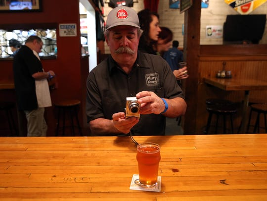 A Russian River Brewing Company customer takes takes