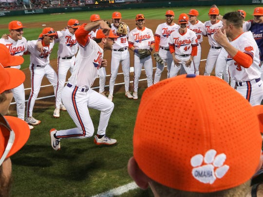 Clemson sophomore pitcher Brooks Crawford (19), right, and Clemson redshirt freshman infielder Grant Cox (3) lead a team huddle before the game with South Carolina on Friday at Doug Kingsmore Stadium in Clemson.