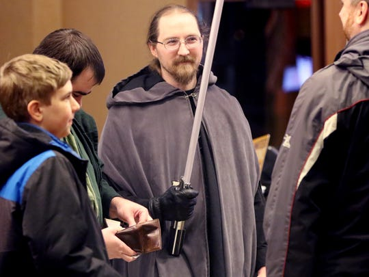 Ben Piotrowski of Milwaukee waits with friends at the