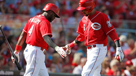 Reds center fielder Billy Hamilton (6) is congratulated by Brandon Phillips during a game against the Blue Jays on June 21.