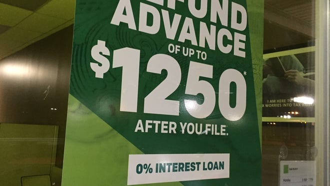 H&R Block promotes its Refund Advance program on storefront windows, like one in Hazel Park in early January.
