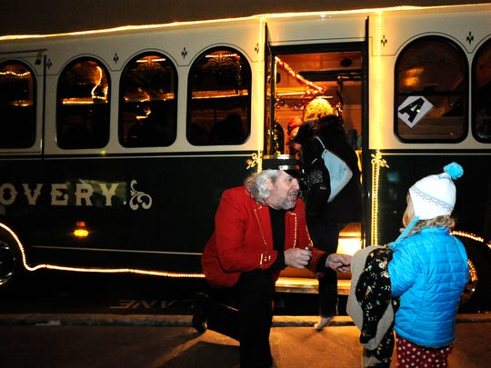 Conductor RJ Skrepenski collects tickets from children